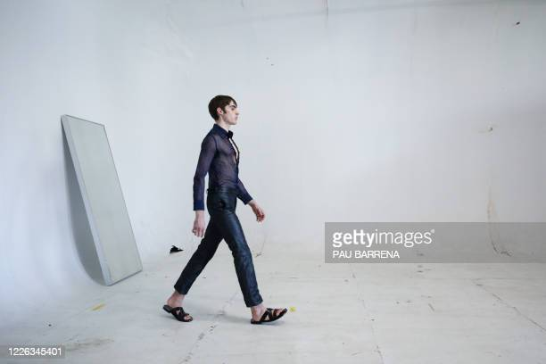 A model walks with a creation by the Spanish fashion designer Archie AlledMartinez during a fitting session ahead of the Paris Fashion Week on June...