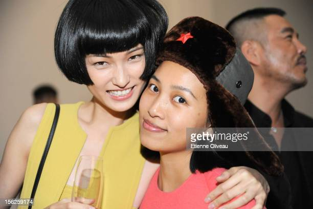 Model Wang Xiao and Fashion photographer Chen Man pose for photos during the Calvin Klein special dinner at the Long March Space in 798 Art District...