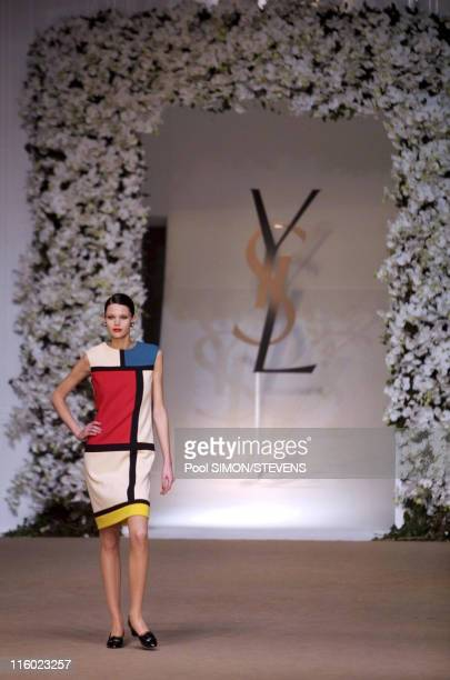A model waring a Mondrian dress walks the runway during Yves Saint Laurent Springsummer 2002 haute couture collections on January 23 2002 in Paris...