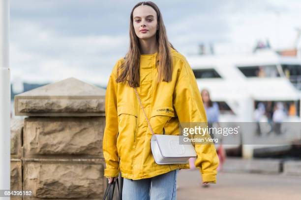A model weairng a white Chanel bag yellow Tommy Hilfiger jacket outside Dyspnea at day 5 during MercedesBenz Fashion Week Resort 18 Collections at...