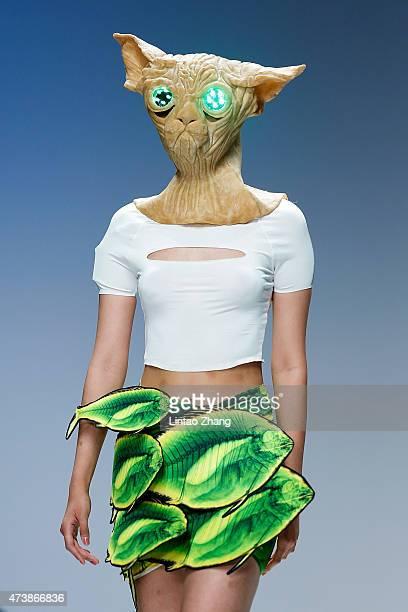 A model wear a mask showcases designs on the runway at Academy of Arts Design Tsinghua University and Nuova Accademia di Belle Arti Milano Graduates...
