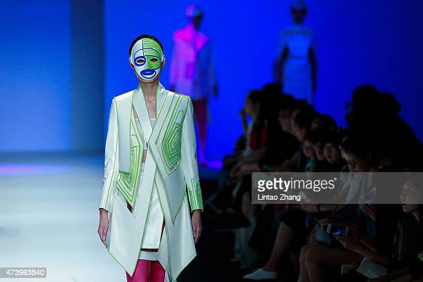 Model wear a mask showcases designs on the runway at Southwest University Graduates Show during the day five of China Graduate Fashion Week at the...