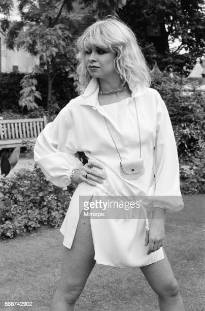 Model wearing 1977 clothing, Sunday Mirror fashion feature, pictured in garden, 2nd August 1977, picture shows model Jo Wood.
