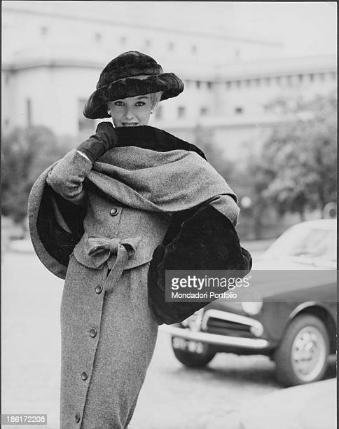 grey wool dress qand shawl with fur lining moleskin hat and muff by the fashion house Balmain established by French fashion designer Pierre Balmain...