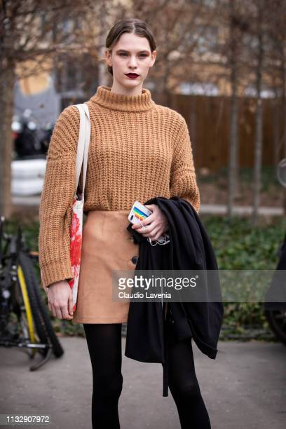 A model wearing a beige sweater and beige mini skirt is seen outside Chloe on Day 4 Paris Fashion Week Autumn/Winter 2019/20 on February 28 2019 in...