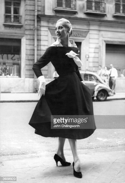 Model wearing a black and white dress with detachable scarf by Lanvin. Original Publication: Picture Post - 7264 - Fashion's New Alphabet - pub.1954