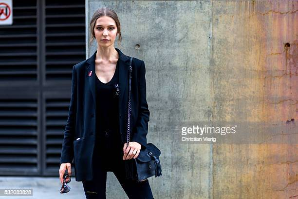 A model wearing a black blazer jacket tshirt and ripped denim jeans outside C Meo Collective at MercedesBenz Fashion Week Resort 17 Collections at...