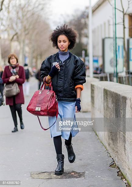 A model wearing a black bomber jacket and red bag outside during the Paris Fashion Week Womenswear Fall/Winter 2016/2017 on March 8 2016 in Paris...