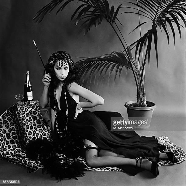 A model wearing a black crepe backless halterneck evening dress by designer Ossie Clark UK 10th October 1971