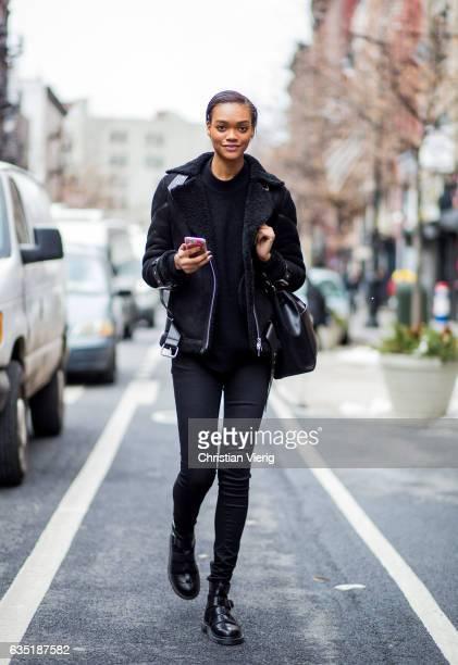 A model wearing a black sheepskin jacket outside Carolina Herrera on February 13 2017 in New York City