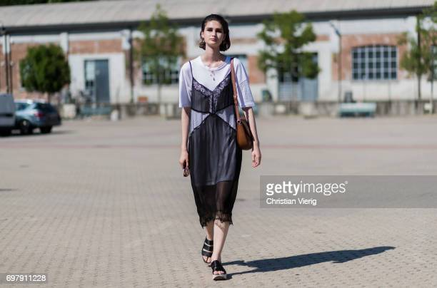 A model wearing a black sheer dress is seen outside Malibu 1992 during Milan Men's Fashion Week Spring/Summer 2018 on June 19 2017 in Milan Italy