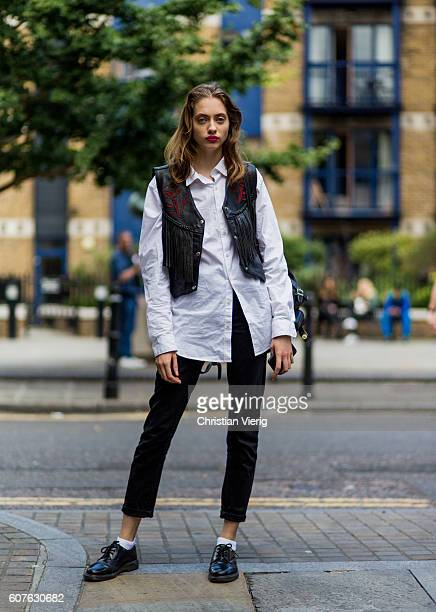 A model wearing a black vest white button shirt outside Topshop during London Fashion Week Spring/Summer collections 2017 on September 18 2016 in...