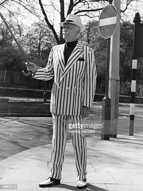 A model wearing a blue and white pinstriped suit and trilby hat at the Crimplene for Men Show London