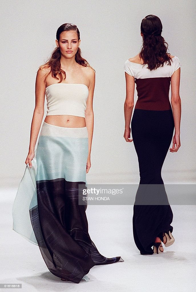 A model wearing a broad striped skirt (L) passes a : News Photo