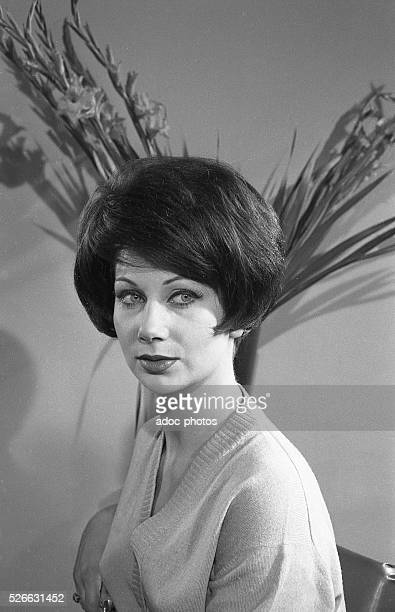 Model wearing a brown wig designed by Jacques Dessange In 1957