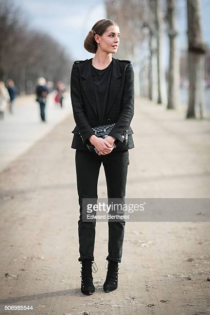 A model wearing a Chanel bag after the Chanel show during Paris Fashion Week Haute Couture Spring Summer 2016 on January 26 2016 in Paris France