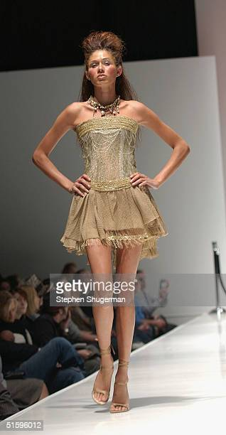 A model wearing a Claire La Faye design walks the runway at the Gen Art show at the MercedesBenz Fashion Week at Hanger 8 on October 27 2004 in Santa...