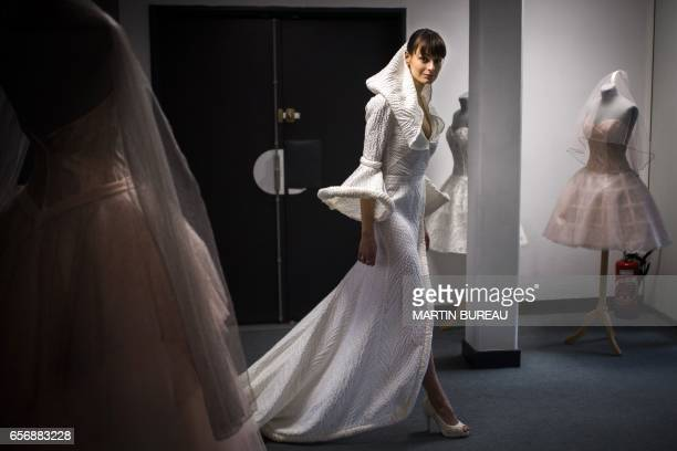 A model wearing a creation of the Cymbeline Wedding Dresses house poses on March 21 2017 at the group's production workshops and offices in Avon in...