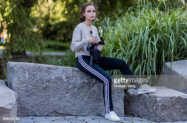 A model wearing a creme sweater and black Adidas track suit pants outside Ida Sjöstedt during the second day of the Stockholm Fashion Week...