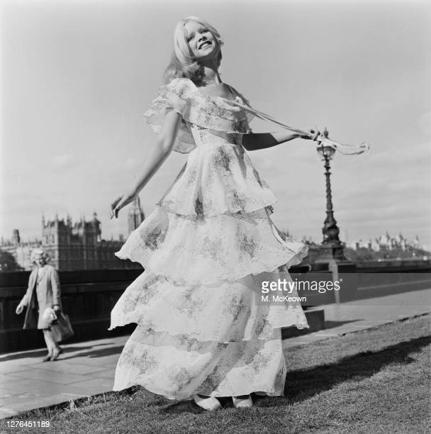 A model wearing a crepe georgette evening dress by Lord John of Carnaby Street on the River Thames in London UK 20th October 1972