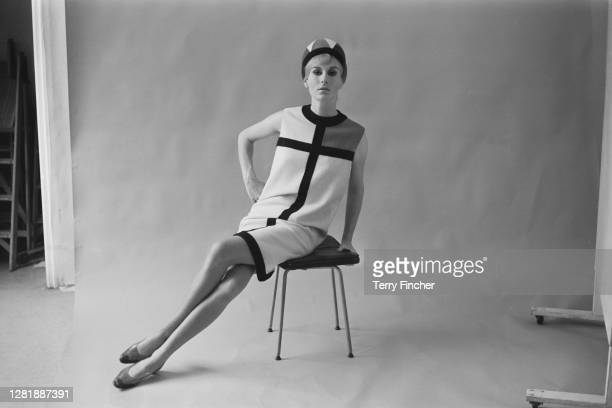 Model wearing a day dress from the Mondrian collection of French fashion designer Yves Saint Laurent, 23rd August 1965. The collection was inspired...