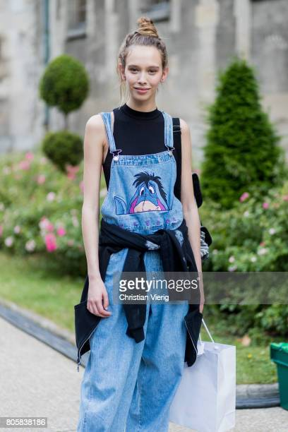 A model wearing a denim overall outside Rodarte during Paris Fashion Week Haute Couture Fall/Winter 20172018 Day One on July 2 2017 in Paris France