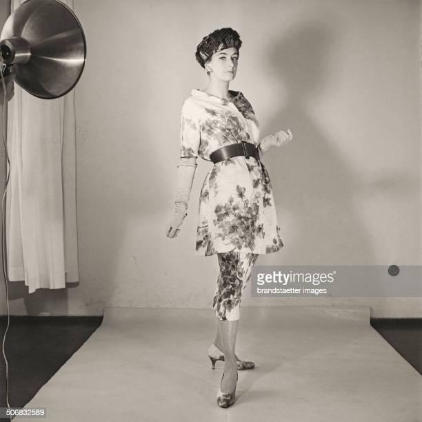 A model wearing a dress by Austrian fashion designer Gertrud Hoechsmann 1956 Photograph by Barbara Pflaum