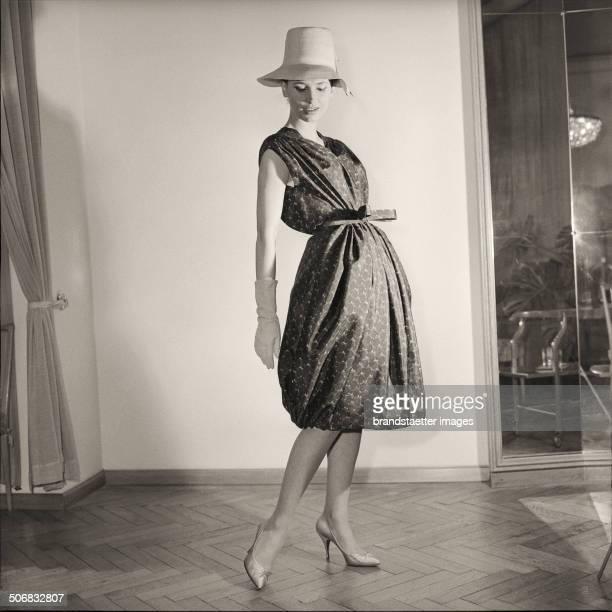 A model wearing a dress by Austrian fashion designer Gertrud Hoechsmann 1960 Photograph by Barbara Pflaum