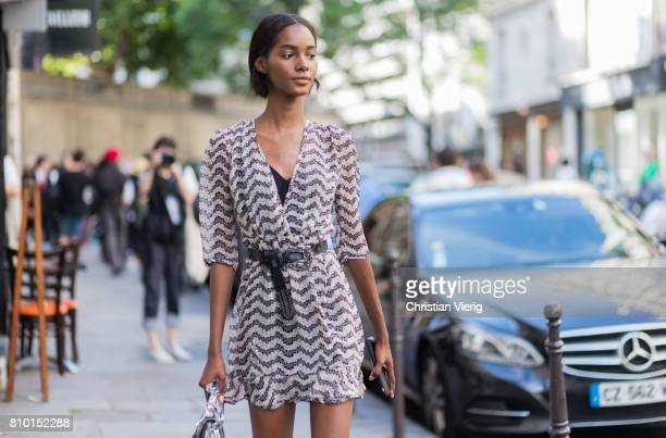A model wearing a dress outside Valentino during Paris Fashion Week Haute Couture Fall/Winter 20172018 Day Four on July 5 2017 in Paris France