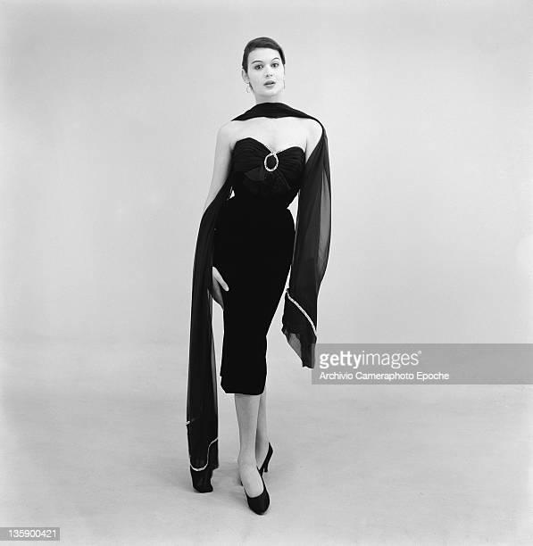 A model wearing a fulllength evening dress by Biki Milan 16th February 1956