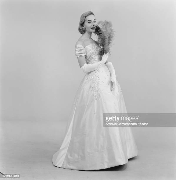 A model wearing a fulllength evening dress by haute couture atelier Rina Milano Milan 16th February 1956