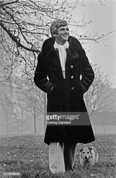Model wearing a fur coat on a winter walk, UK, 28th November 1973.
