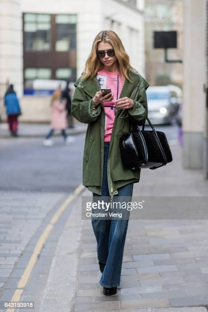 A model wearing a green jacket and a pink track suit jacket outside Julien Macdonald on day 2 of the London Fashion Week February 2017 collections on...