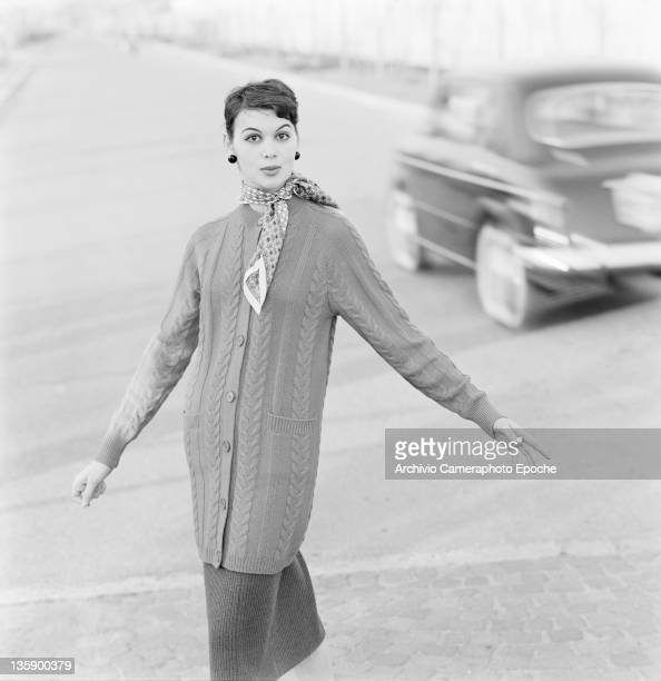 A model wearing a knitted cardigan with a neckerchief Italy circa 1955