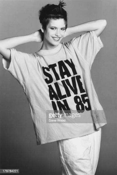 A model wearing a large tshirt with the slogan 'Stay Alive in 85' December 1984
