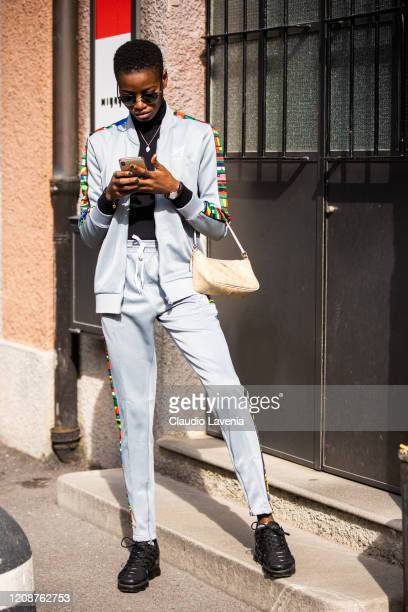 Model, wearing a light blue decorated sweatshirt with matching pants and Coach bag, is seen outside Emporio Armani show, during Milan Fashion Week...