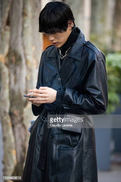 Model, wearing a long black leather jacket, black pants and black Balenciaga bag, is seen outside the Heron Preston show during the Paris Fashion...