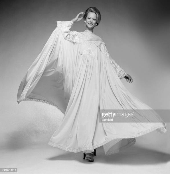 Model wearing a long dress created by British fashion designer Zandra Rhodes photographed in the Studio on 22nd November 1973