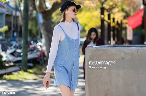 A model wearing a long shirt dress cap at day 3 during MercedesBenz Fashion Week Resort 18 Collections at Carriageworks on May 16 2017 in Sydney...