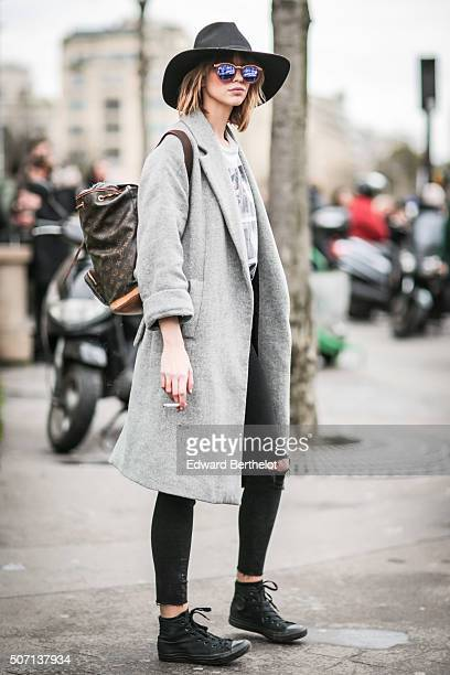 A model wearing a Louis Vuitton bag after the Elie Saab show during Paris Fashion Week Haute Couture Spring Summer 2016 on January 27 2016 in Paris...