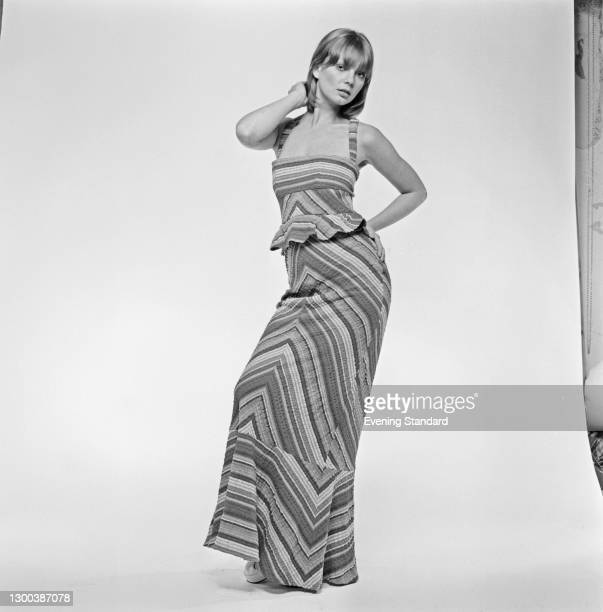 Model wearing a maxi dress in broad zig-zag stripes, UK, 15th June 1972.