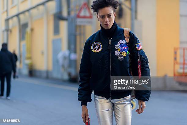 Model wearing a navy NASA bomber jacket, silver pants at Wood during Milan Men's Fashion Week Fall/Winter 2017/18 on January 16, 2017 in Milan, Italy.