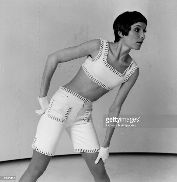 A model wearing a pair of shorts and croppedtop by Courreges