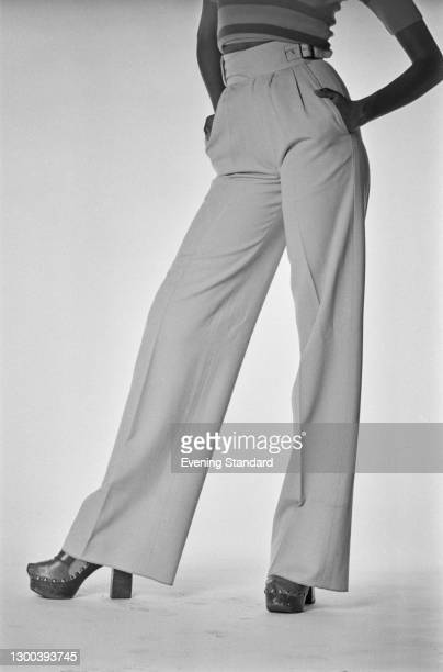 Model wearing a pair of wide-legged trousers, UK, 14th August 1972.