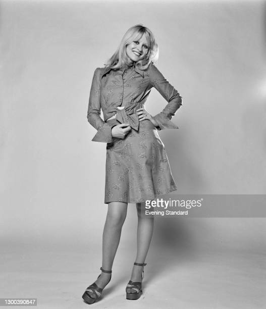 Model wearing a patterned skirt just above the knee and a matching blouse, tied at the front, UK, 13th July 1972.