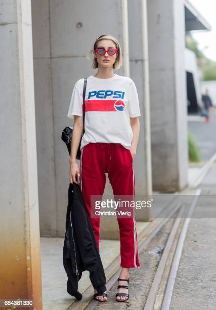 A model wearing a Pepsi tshirt red track suit pants sandals at day 5 during MercedesBenz Fashion Week Resort 18 Collections at Carriageworks on May...