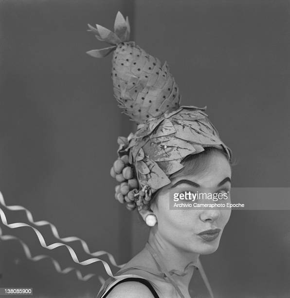 Model wearing a pineapple hat as a Carnival mask Venice 1960