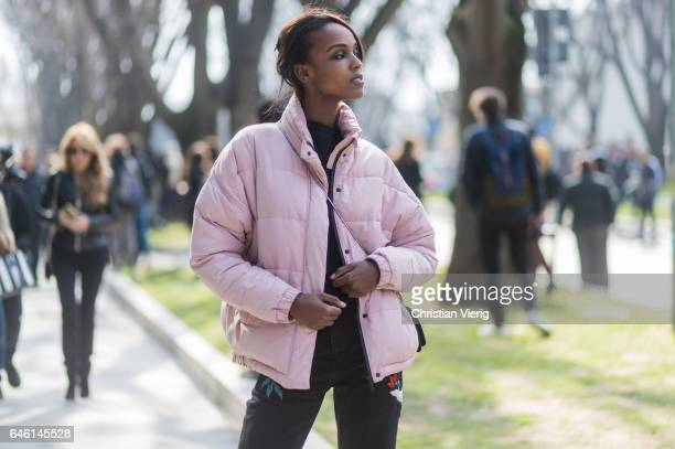 A model wearing a pink down feather jacket outside Armani during Milan Fashion Week Fall/Winter 2017/18 on February 27 2017 in Milan Italy