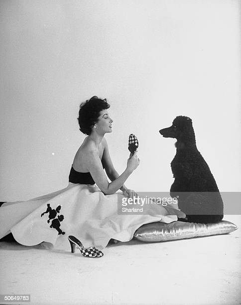A model wearing a poodle petticoat worn as a skirt or to hold a skirt out
