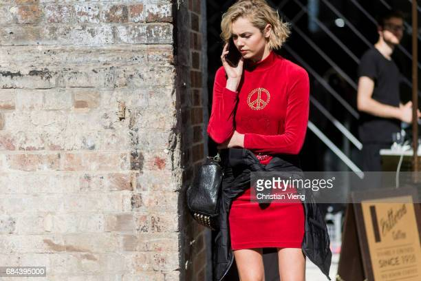 A model wearing a red velvet dress at day 5 during MercedesBenz Fashion Week Resort 18 Collections at Carriageworks on May 18 2017 in Sydney Australia